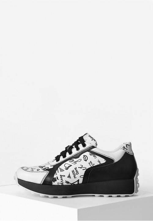 Кожаные кроссовки черно-белого цвета